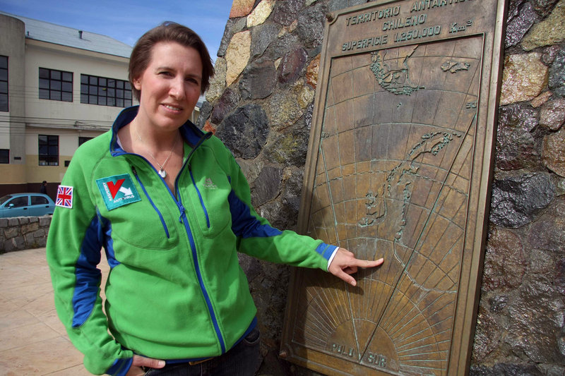 British adventurer Felicity Aston shows a map in Punta Arenas, Chile, early this month. Aston, who plans to ski by herself across Antarctica, would set a record for the longest solo polar expedition by a woman, at about 70 days.