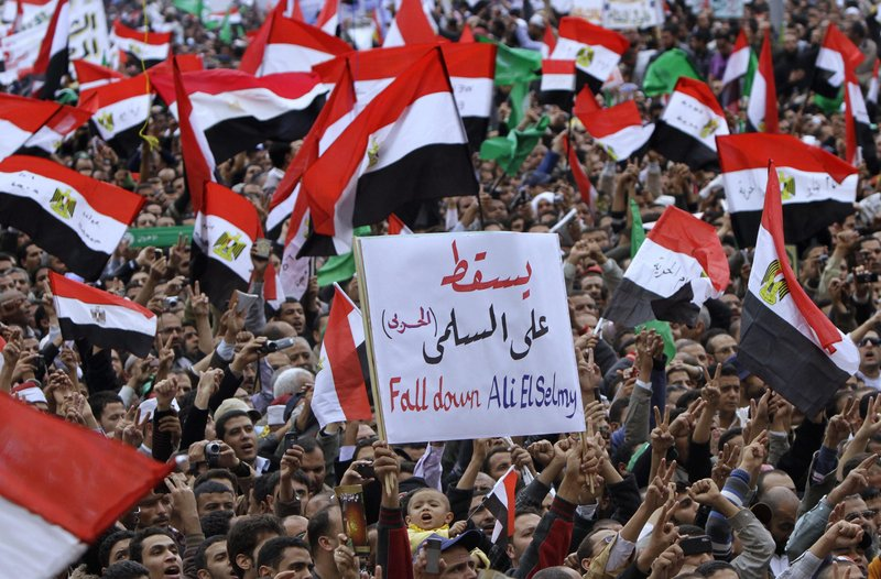 Protesters shout anti-military slogans in Tahrir Square, the focal point of the uprising that ousted President Hosni Mubarak, in Cairo on Friday.