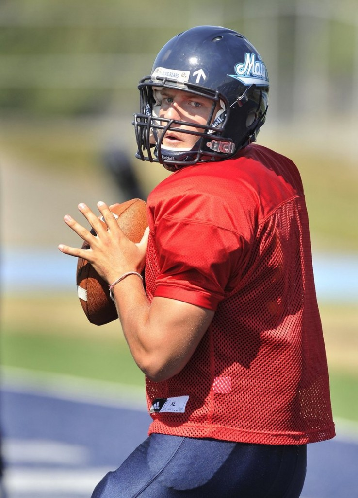 Warren Smith remains the center of Maine's offense at quarterback and will be needed today at UNH.
