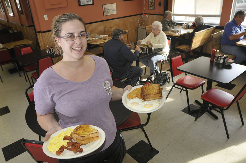 Andrea Thompson, a waitress at Q Street Diner in South Portland, serves breakfast to her customers.