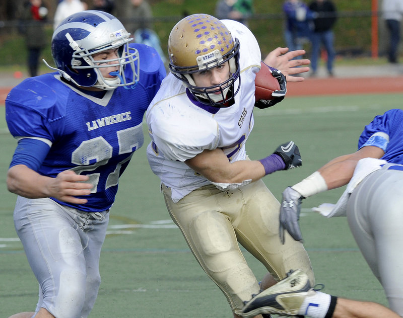 Donald Goodrich turned in an outstanding performance for Cheverus in the Class A final Saturday, scoring five TDs. On this play, he finds room between two Lawrence defenders, including Beau Grenier, left.