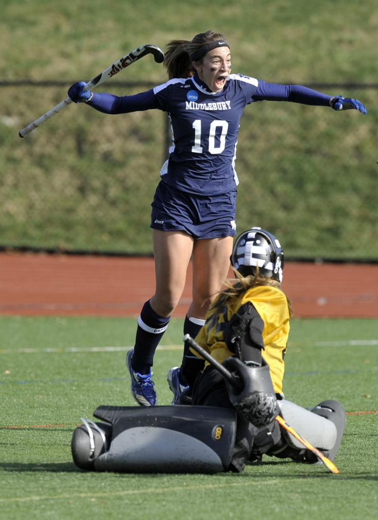 Lucy Jackson celebrates after scoring the first goal Saturday against Bowdoin's Kayla Lessard, starting Middlebury on its way to a 3-0 victory in an NCAA Division III field hockey semifinal.