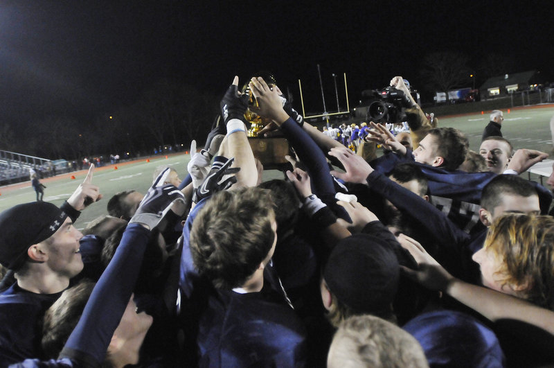 Yarmouth earned its second consecutive Gold Ball and ran its two-year winning streak to 24 games by taking command early and rolling to a 41-14 victory against Bucksport in the Class C state final at Fitzpatrick Stadium.