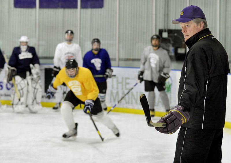 Dan Lucas, Cheverus boys' hockey coach, keeps a close eye on the first practice of the season Monday. The boys' hockey season begins Dec. 9, the girls start Friday.