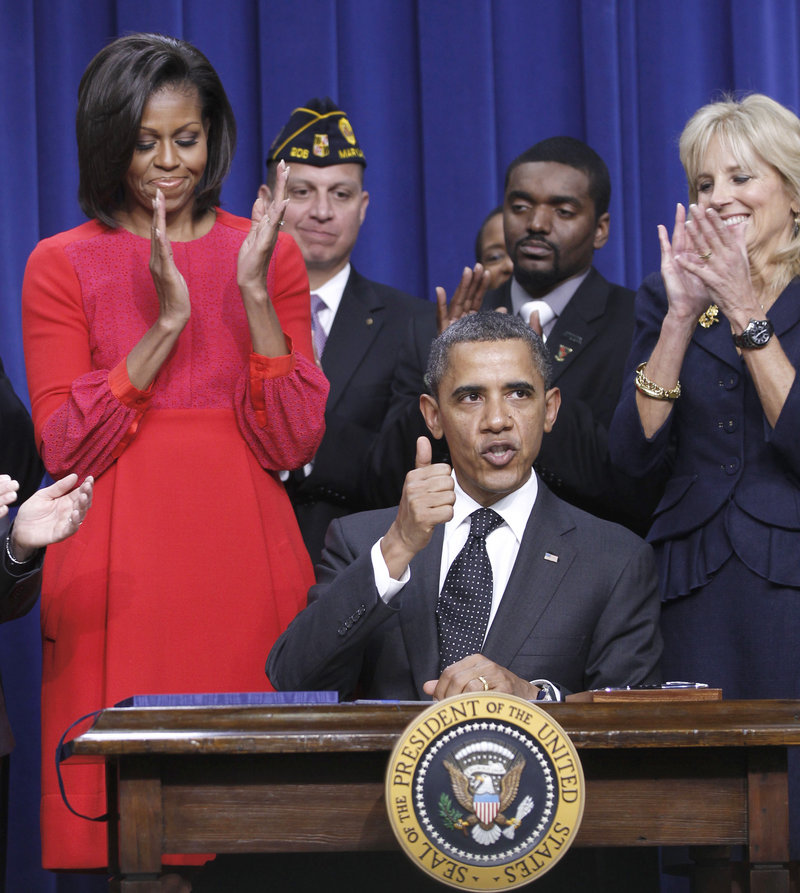 President Obama gives a thumbs-up Monday after signing legislation that will provide tax credits to help put veterans back to work. Today, he is scheduled to visit New Hampshire, where he'll promote elements of his stalled jobs plan.