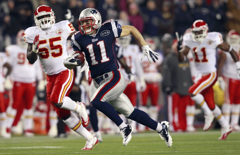 Julian Edelman returns a punt 72 yards for a touchdown Monday night in the Patriots' 34-3 win over the Kansas City Chiefs at Gillette Stadium.