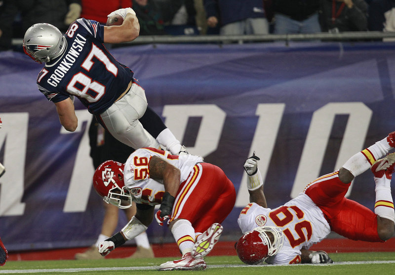 Ron Gronkowski was an offensive force Monday night for the New England Patriots in their, 34-3 victory against the Kansas City Chiefs. Gronkowski scored on pass plays of 52 and 19 yards from quarterback Tom Brady, bulling his way to the end zone both times to help the Pats improve to 7-3.