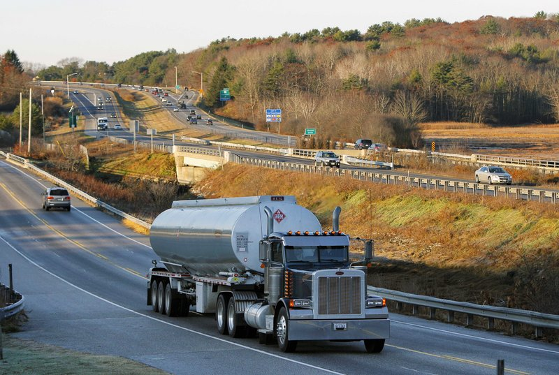 A heavy truck travels north on two-lane Route 1, alongside four-lane Interstate 295, in Yarmouth. Congress has added Maine and Vermont to the list of states where trucks heavier than 80,000 pounds can operate on federal highways.