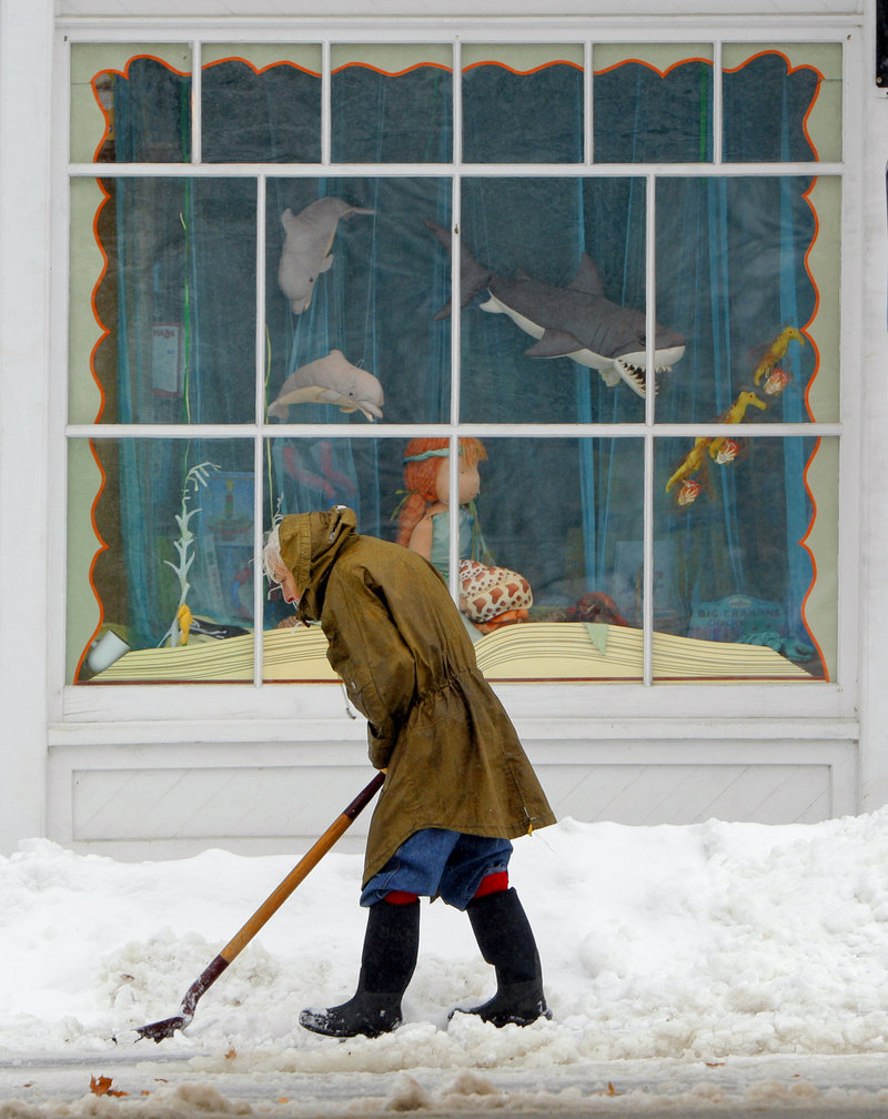 Eighty-six-year-old Jane Bryant shovels snow in front of her home on Route 5 in Limerick on Wednesday.