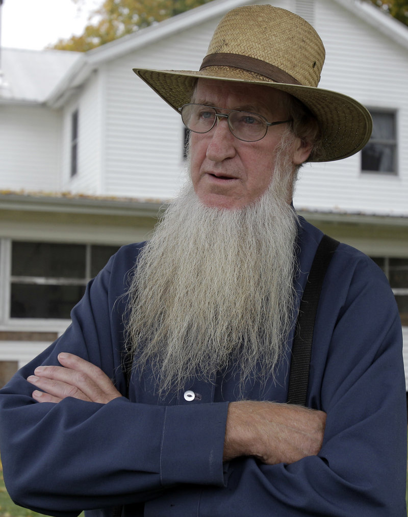 Sam Mullet, the leader of a breakaway Amish group, was charged Wednesday along with six others for hate crimes in hair-cutting attacks against other Amish.
