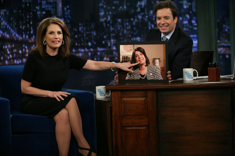 "Michele Bachmann, in this NBC photo, points to a photo of Jimmy Fallon dressed as Bachmann, during her visit to ""Late Night with Jimmy Fallon"" Tuesday."