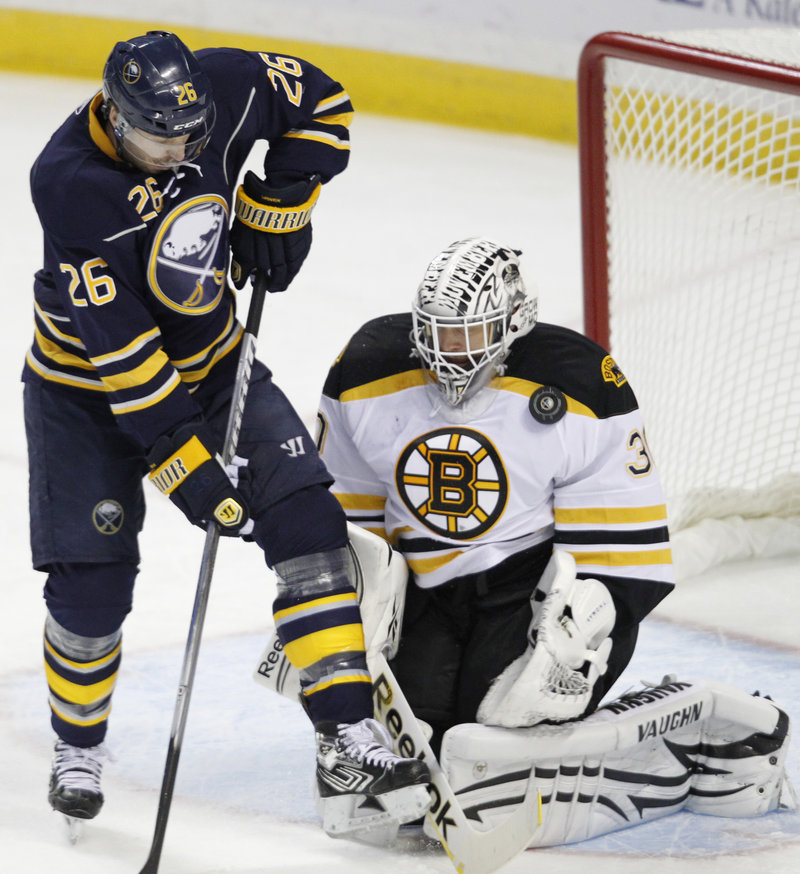 Boston goalie Tim Thomas blocks a shot by Thomas Vanek of the Buffalo Sabres in the first period Wednesday night. The Bruins increased their winning streak to 10 games.