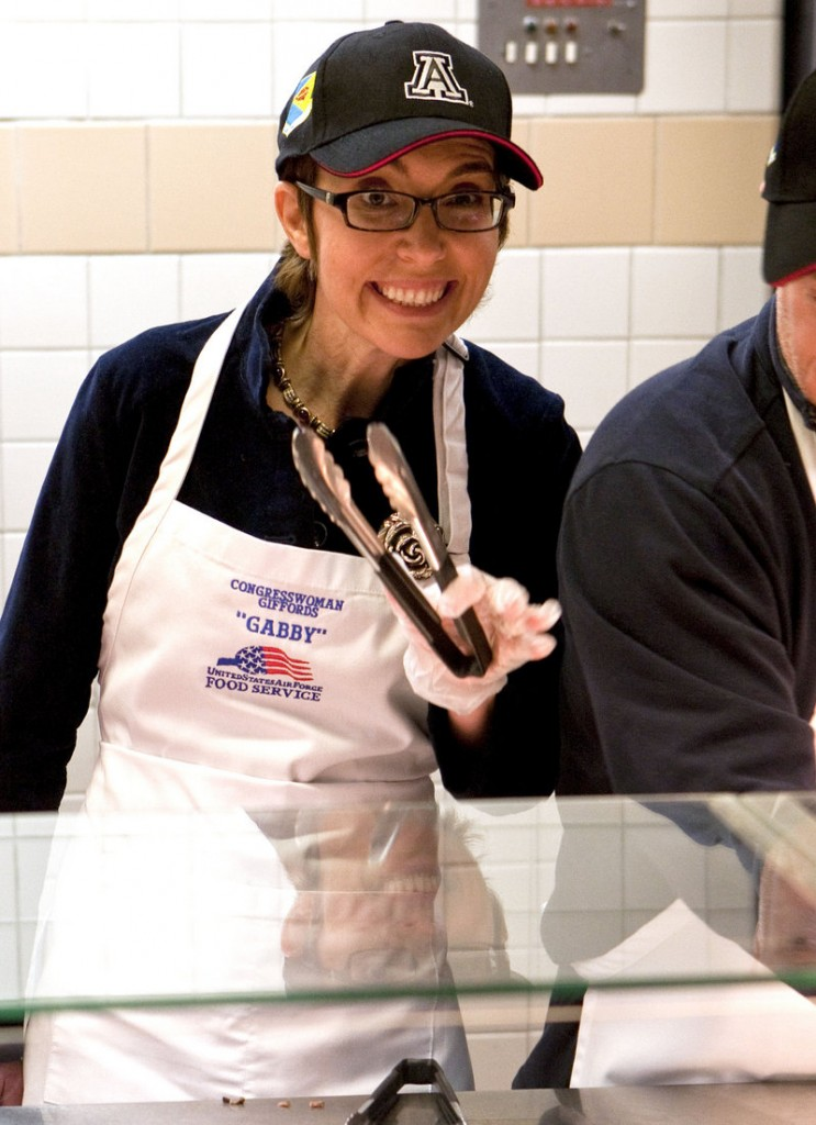 Rep. Gabrielle Giffords, who was shot in the head in January, serves Thanksgiving dinner Thursday at Davis-Monthan Air Force Base in Tucson, Ariz.