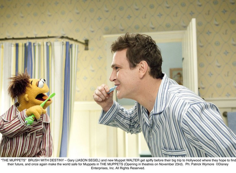 "Gary (Jason Segel) and new Muppet Walter in ""The Muppets."""