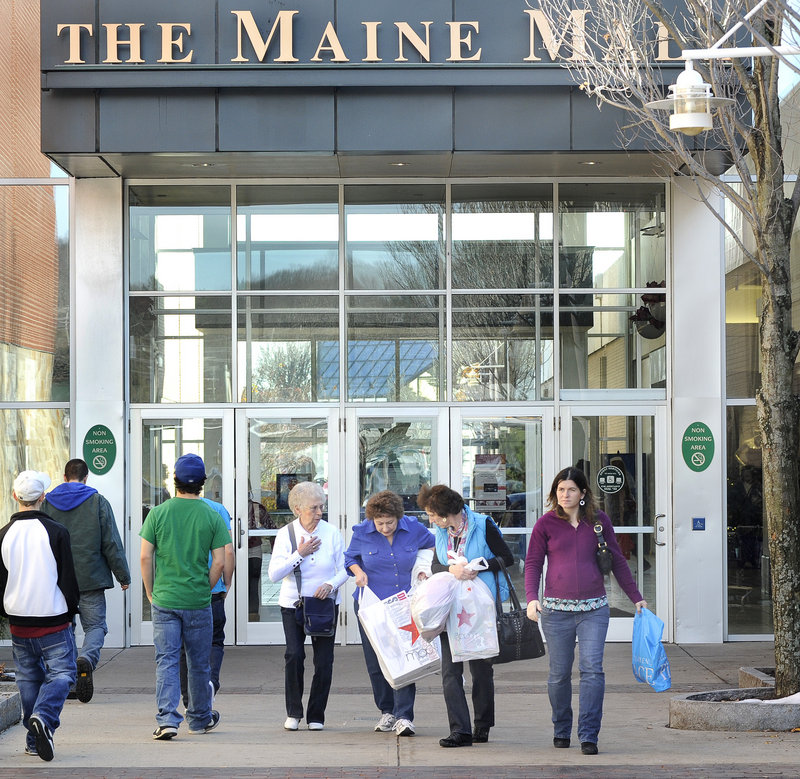 Family members Betty Willette of East Winthrop, Sandy Robinson of Penobscot, Sheree Wess of East Winthrop and Holly Wess of Madison compare notes Friday at the Maine Mall, where the crowds were well-behaved, the mall's general manager said.