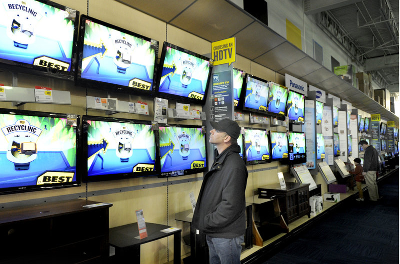 Jamie Morrisseau of Harrison checks out televisions at Best Buy on Friday. The store sold out of 42-inch Sharp LCD televisions for $199.99 before it even opened at midnight.