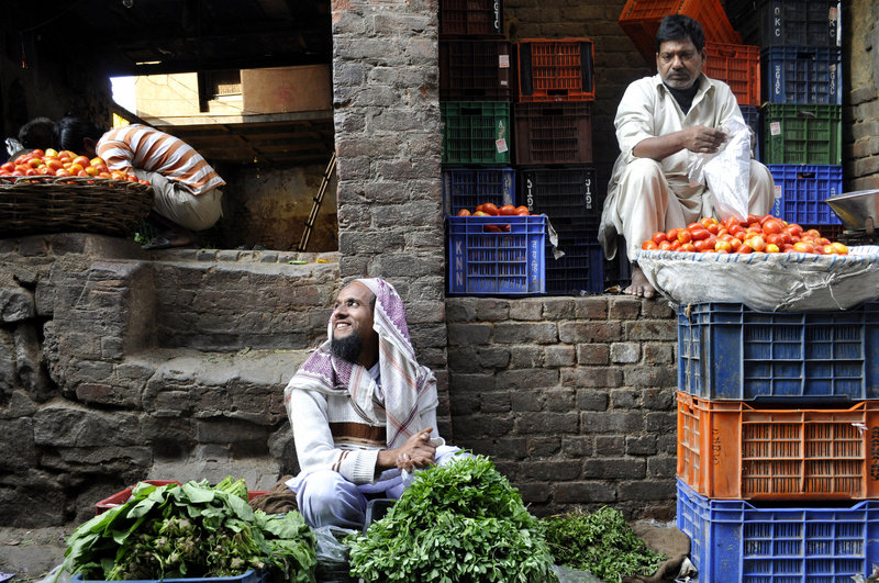 Street vendors sell vegetables in New Delhi, India. India is the world's second-largest grower of fresh produce, but more than one-third of fruits and vegetables rot because of lack of refrigeration and transportation, and corruption.