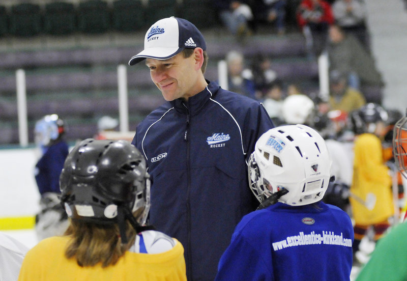 Want to know what's going on with UMaine? A couple of kids go right to the source – Coach Tim Whitehead – during a clinic Friday at Family Ice Center in Falmouth.