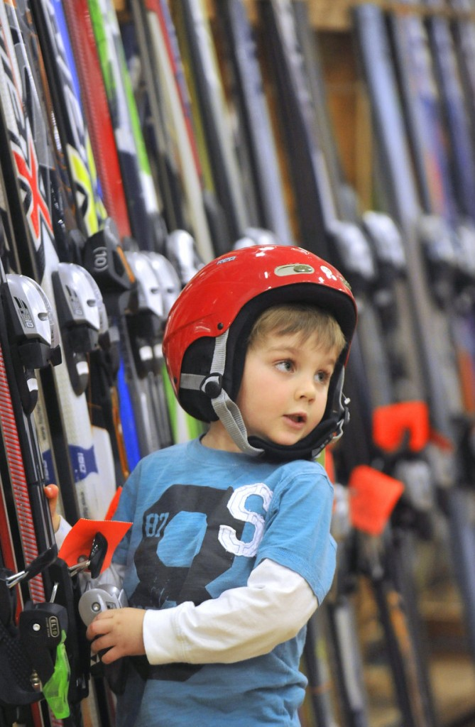 Jack Reagan, 4, of Falmouth checks out the ski selection while wearing a newly acquired ski helmet.