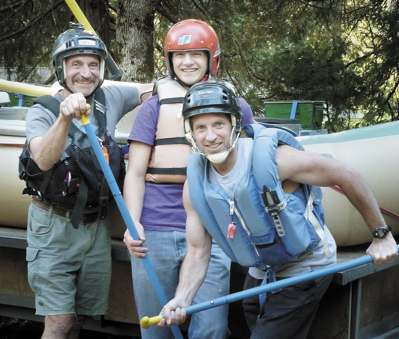Ken Walsh, right, of Vassalboro, poses during a rafting trip this summer in Oregon that retraced a 2006 trip during which his cousin Spencer Funk, center, was bitten by a rattlesnake. Walsh ran five miles in darkness to summon help. At left is Spencer's father, Roger Funk.