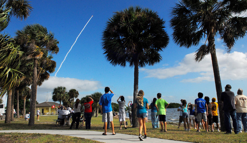 Crowds gather in Kelly Park on Merritt Island, Fla., to watch the launch of the NASA rover Curiosity from Cape Canaveral Air Force Station, Fla., on Saturday. More than 13,000 invited guests jammed the Kennedy Space Center on Saturday morning to witness NASA's first launch to Mars in four years, and the first flight of a Martian rover in eight years.