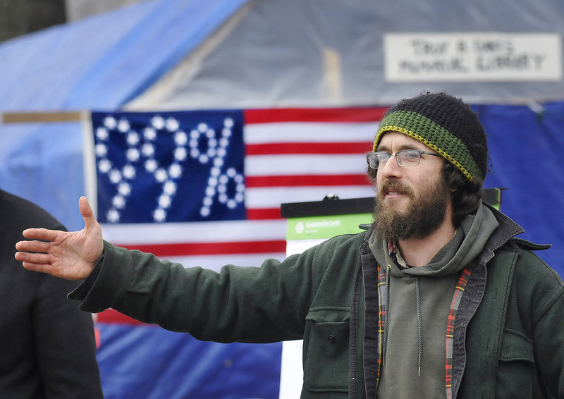 Jonah Fertig of Portland addresses a crowd of about 50 people at a meeting of Occupy Maine in Lincoln Park in Portland on Sunday.