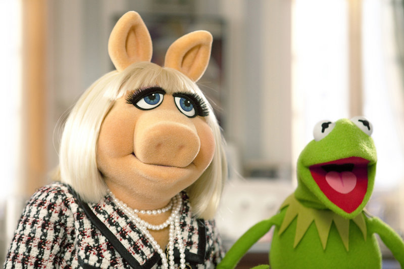 "Kermit the Frog tries to persuade Miss Piggy to help save The Muppet Theater from being torn down in a scene from ""The Muppets."" The movie debuted at No. 2 at the three-day weekend box office."