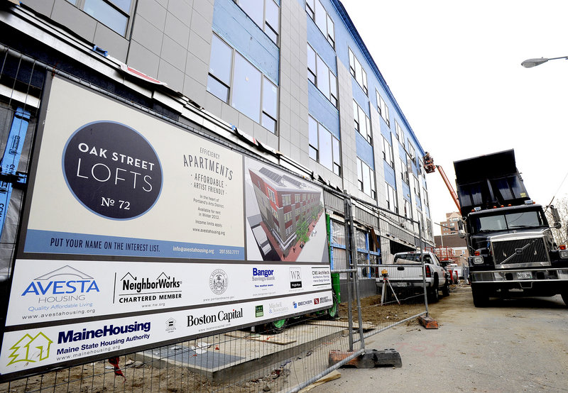 Construction continues at Oak Street Lofts in Portland, which has scheduled an open house for noon Saturday.
