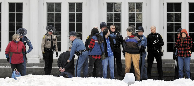 Protesters are arrested Sunday on the lawn of the Blaine House during a rally by Occupy Augusta. Police said nine people were charged with criminal trespass and failure to disperse after refusing to leave the lawn of the governor's mansion.
