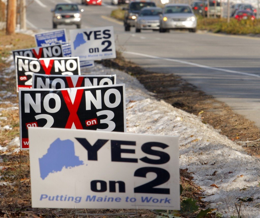 "Signs along Route 111 in Biddeford express differing views on Biddeford Downs. Anxious about offending customers, a local businessman wouldn't give his last name, adding, ""I have no position"" on the proposal."