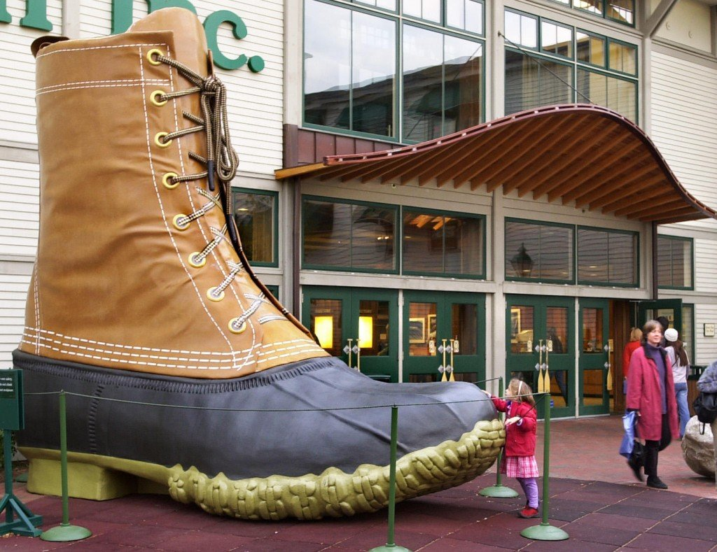 Staff Photo by Gordon Chibroski, Thursday, October 24, 2002: Annarosa Whitman, 5 years old, gives the big L.L. Bean boot a pat as she leaves the popular store. L.L. Bean is hosting a Holiday Book Festival this weekend.