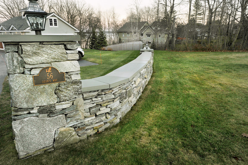 L.L. Bean President and CEO Chris McCormick must remove a stone wall and cedar fence that run along an easement used by his Cumberland neighbors to access the water, a judge ruled.