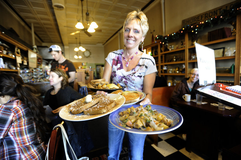 Server Debbie Thibodeau serves breakfast at Brea Lu in Portland.