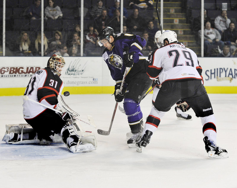 Linden Vey of the Manchester Monarchs seeks a rebound Wednesday night after being stymied by goalie Curtis McElhinney of the Portland Pirates.