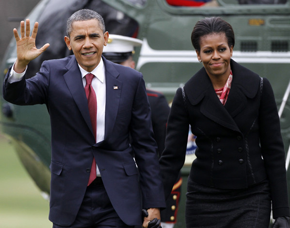 President Barack Obama and first lady Michelle Obama arrive on the South Lawn of the White House in this 2011 photo.