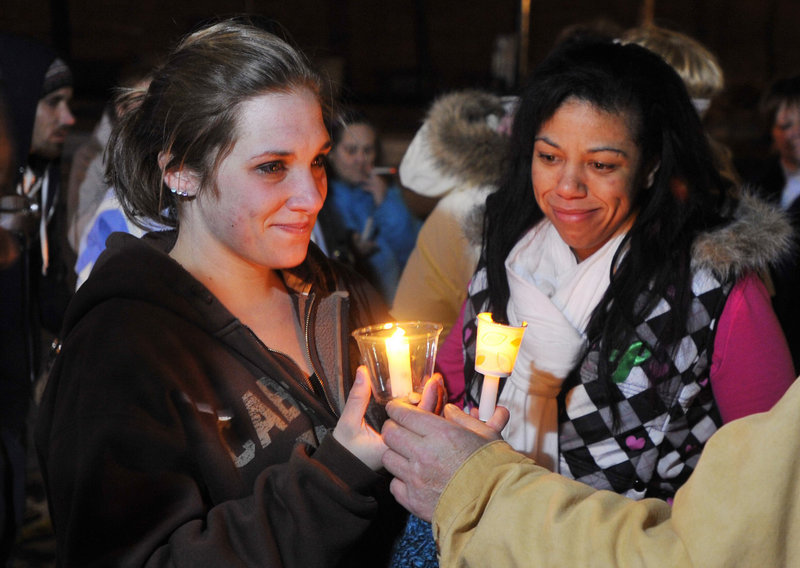Ayla's mother, Trista Reynolds, left, attends a candlelight vigil in Portland on Dec. 23.