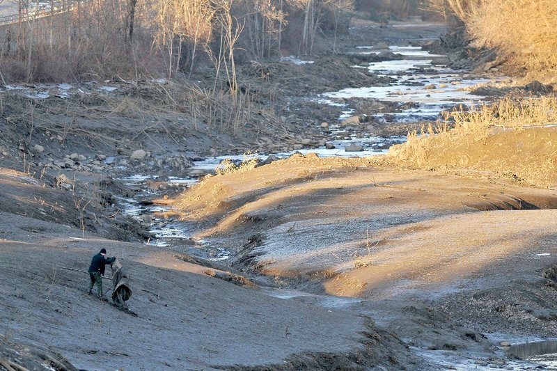A stretch of the Messalonskee River is drained as part of the intensive search for 20-month-old Ayla Reynolds in Waterville on Dec. 20.