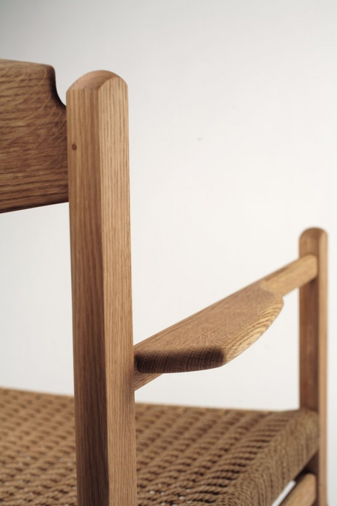 A close-up of Peter Turner's Arrow chair shows the flared armrest.
