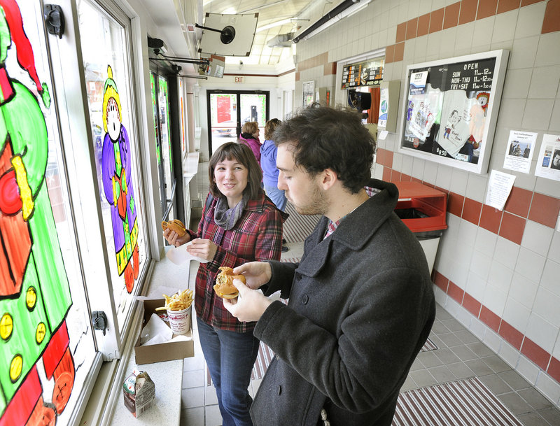 Richele Grenier of Old Orchard Beach and Sam Chattow of South Portland enjoy burgers at Rapid Ray's in Saco.