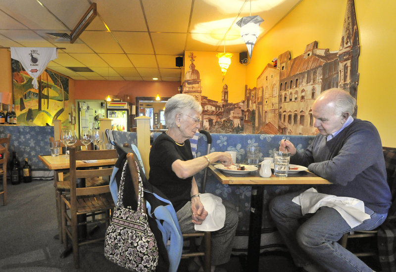 Eleanor Panzuto of Portland enjoys lunch at Bibo's Madd Apple Cafe in Portland with her nephew, Frank Pandolfo, also of Portland. The restaurant has long been a popular stop with theater goers heading for the nearby Portland Stage Company.
