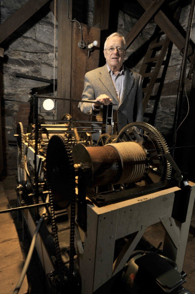 Jenks shows the clockworks, which keep the steeple's three clocks on time. The church is believed to have the last functioning Simon Willard tower clock in the country, making the renovation work more delicate. During the refurbishing, the belfry will be removed and taken to Barre, Vt., for the interior and exterior work.