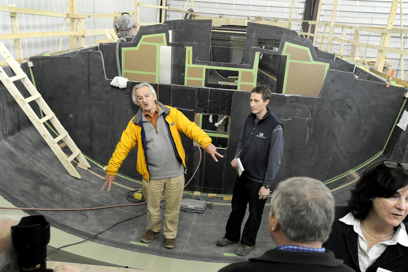 Stanley Paris, left, and Lyman-Morse project manager Lance Buchanan stand inside the hull mold of the Kiwi Spirit, which Paris plans to sail around the globe next year.