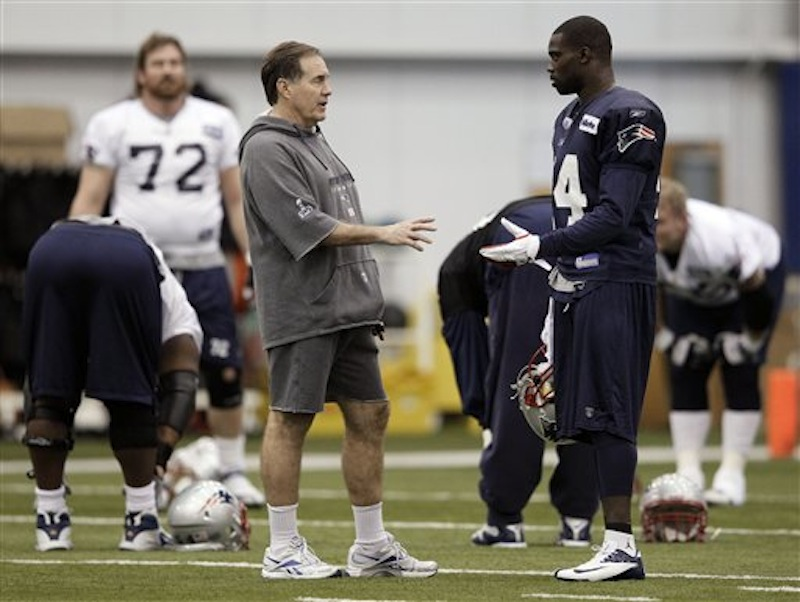 New England Patriots head coach Bill Belichick talks with strong safety James Ihedigbo (44) during practice on Thursday, Feb. 2, 2012, in Indianapolis. The Patriots will face the New York Giants in NFL football Super Bowl XLVI on Sunday. (AP Photo/Mark Humphrey)