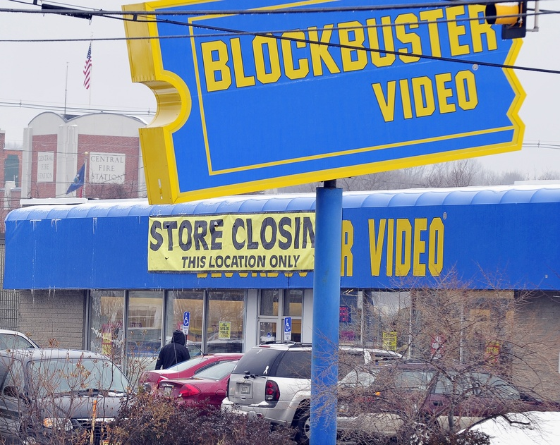 A customer heads into a Blockbuster location at 219 Waterman Drive in South Portland on Wednesday. This store and two others in Maine – one in Westbrook and another in Lewiston – are either closed or in the process of closing as part of a business decision by Blockbuster's parent company, Dish Network.