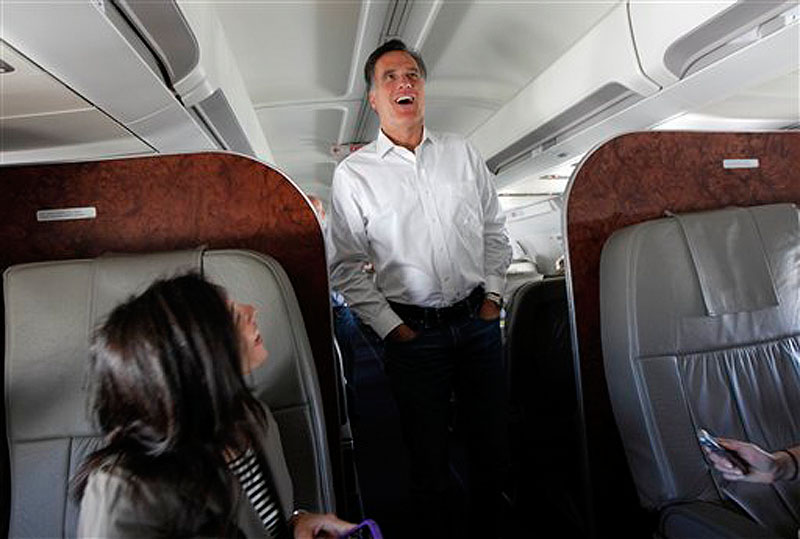 Republican presidential candidate, former Massachusetts Gov. Mitt Romney talks to reporters on his campaign plane en route from Tampa, Fla. to Minnesota on Wednesday, Feb. 1, 2012. (AP Photo/Gerald Herbert)