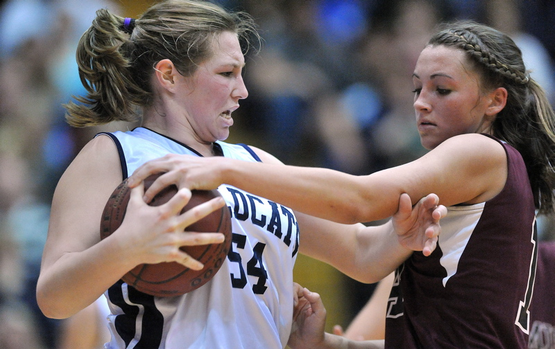 Kylie Richards, right, of Nokomis defends against Meredith Stewart of Presque Isle.