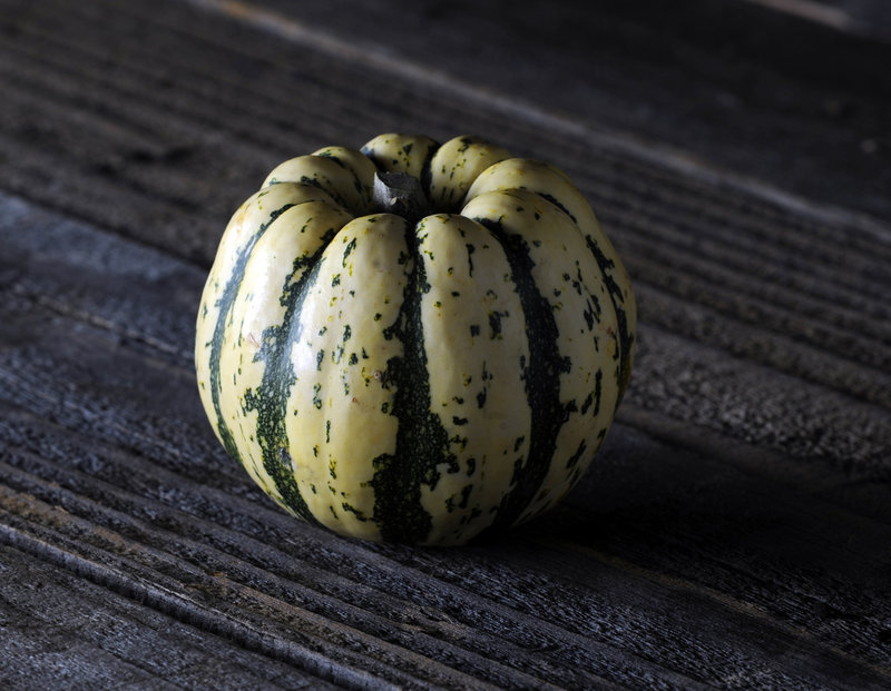 Elongated, with tender, pale yellow skin, the delicata squash has very sweet, pale orange flesh and an edible peel.