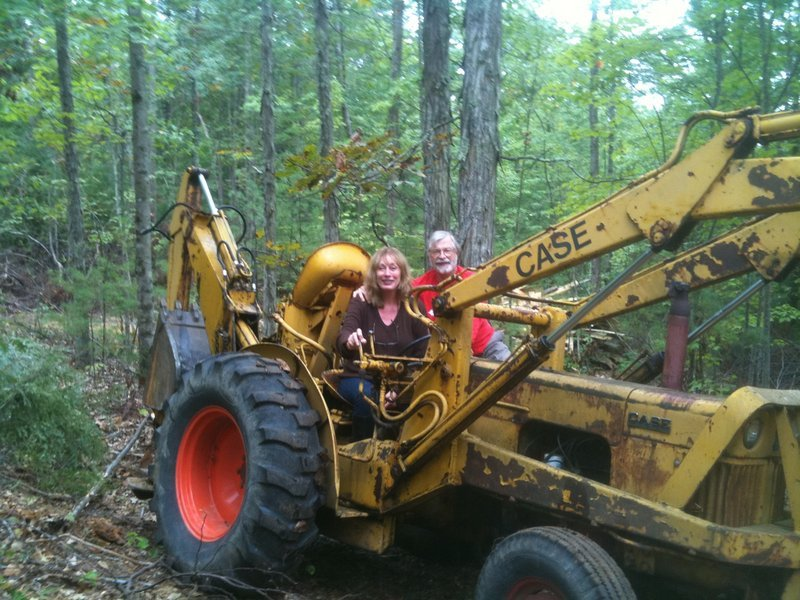Gayle Lynds and John C. Sheldon in their backhoe.