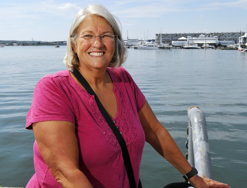 Pat Gallant-Charette, who swam across the English Channel last year, encourages young and old to visit one of the 14 community pools in Maine offering free admission today.
