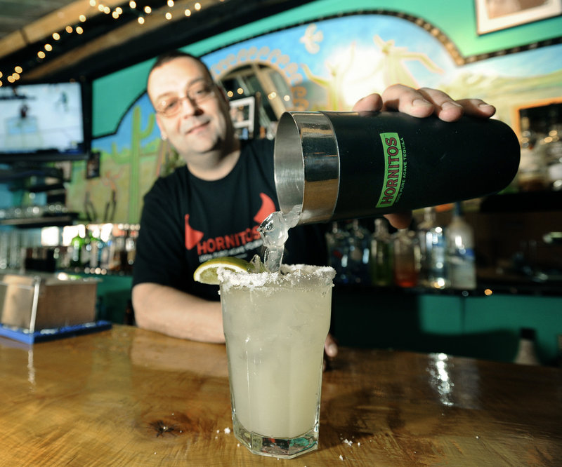General manager and bartender Randy Ouellette pours a Mesa Verde margarita.